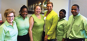 Lisa C. Perry-Gilkes, MD, third from left, heads the Polaris Medical Group-ENT, LLC.