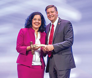 In an Opening Ceremony moment, AAO-HNS/F President Sujana Chandrasekhar, MD, (left) received a Past President's gavel and pin from new President Gregory Randolph, MD.